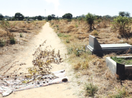 The spot where a Pelandaba West man was murdered while his wife sustained injuries. Inset: Mourners outside the deceased's house