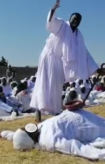 File Picture of a woman at a Madzibaba shrine