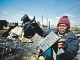 ALL GONE: Gogo Florence Ndlovu says she lost everything, and all she could get were these burnt items. Photo by Lucky Morajane.