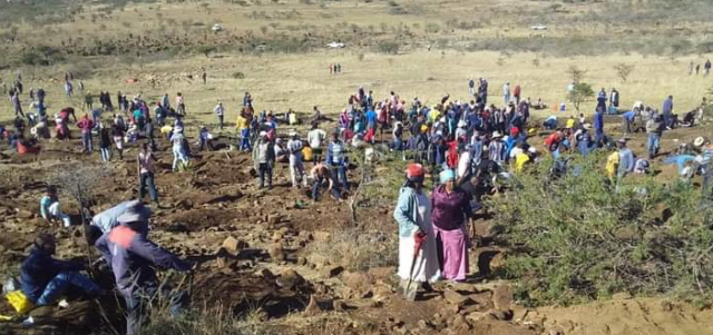 Villagers digging stone they believe is a diamond. Photos supplied.