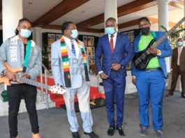 Youth, Sport, Arts and Recreation Deputy Minister, Tinoda Machakaire with President Emmerson Mnangagwa and two artists