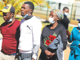 Suspected robbers arrive at Harare Magistrates Court yesterday.